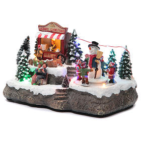 Christmas village with Ring a Ring-o' roses game and snowman  25x15x15 cm s2