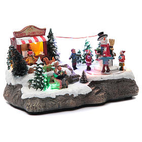 Christmas village with Ring a Ring-o' roses game and snowman  25x15x15 cm s3