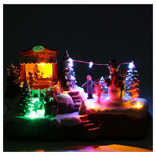 Christmas village with Ring a Ring-o' roses game and snowman  25x15x15 cm 5