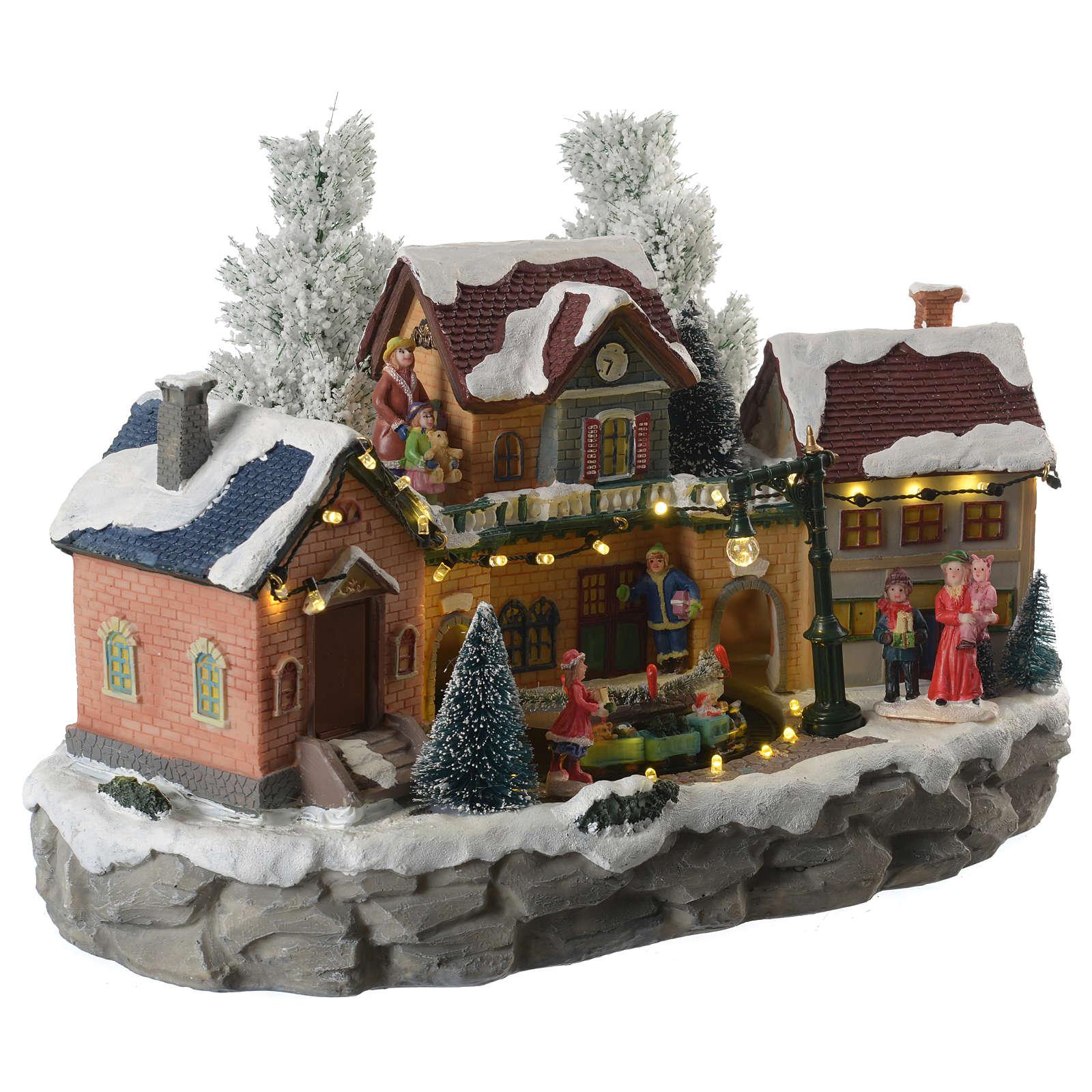 Pueblo Navideño en miniatura invernal con trenecito en movimiento 3