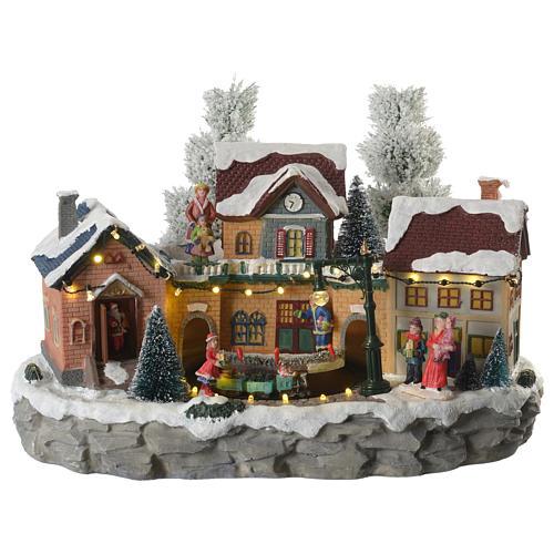 Pueblo Navideño en miniatura invernal con trenecito en movimiento 1