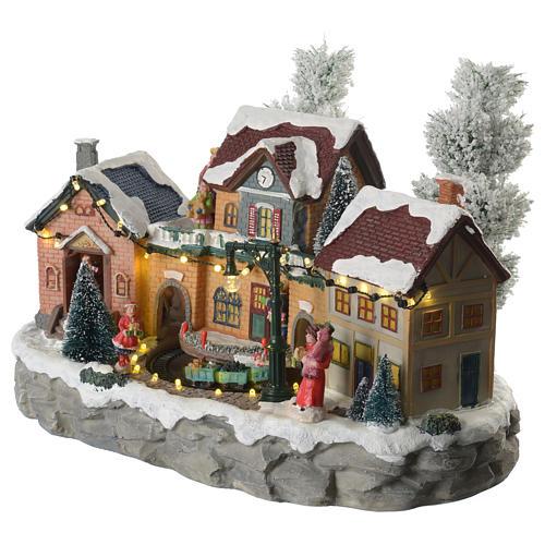 Pueblo Navideño en miniatura invernal con trenecito en movimiento 2