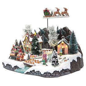 Winter village with Father Christmas's sleigh 30x25x25 cm s2