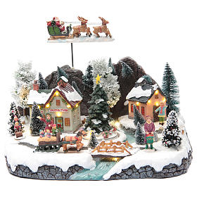 Winter village with Father Christmas's sleigh 30x25x25 cm s1