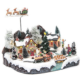 Winter village with Father Christmas's sleigh 30x25x25 cm s3