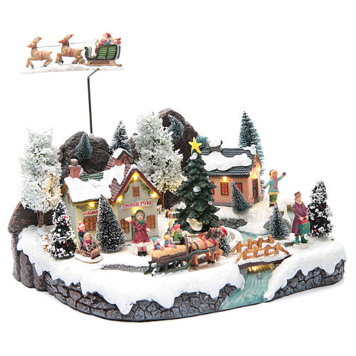 Winter village with Father Christmas's sleigh 30x25x25 cm 3