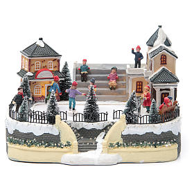 ice skaters for Christmas village 20x20x20 cm with lights and music s1