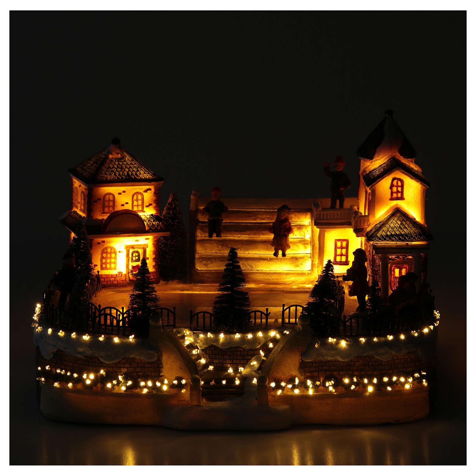 Patinadores Pueblo Navideño 20x20x20 cm luces y música 3