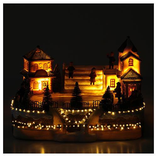 Patinadores Pueblo Navideño 20x20x20 cm luces y música 5
