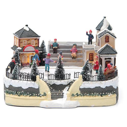 Pattinatori villaggio natalizio 20x20x20 luci, musica 1