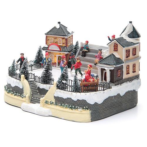 Pattinatori villaggio natalizio 20x20x20 luci, musica 2