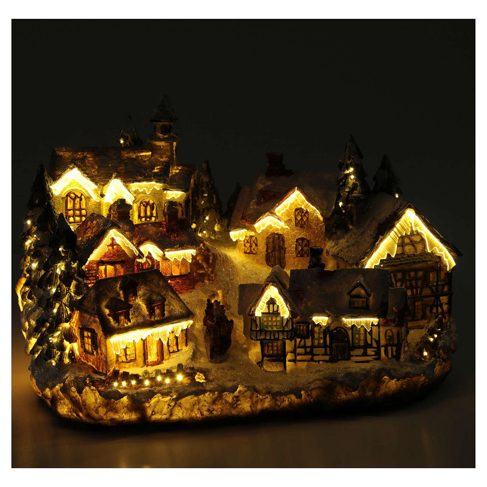 Villaggio natalizio con chiesa 30x20x20 cm 3