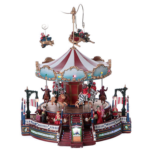 Carrusel navideño en movimiento 25x30x25 cm 1