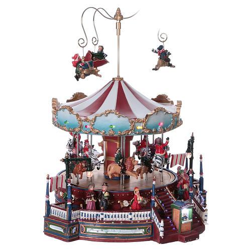 Carrusel navideño en movimiento 25x30x25 cm 4