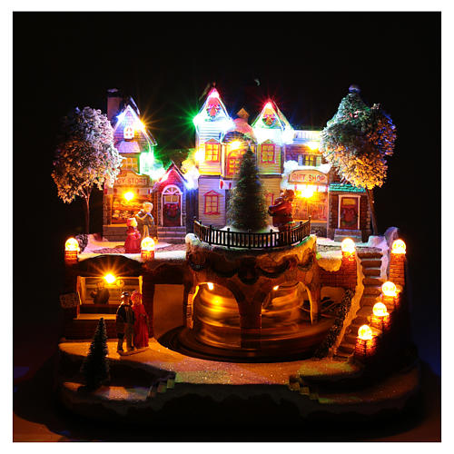 Christmas village with moving train 25x25x20 cm 4