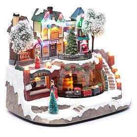 Paisaje navideño con tren en movimiento, iluminación y música 25x25x20 cm s3