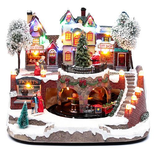 Paisaje navideño con tren en movimiento, iluminación y música 25x25x20 cm 1