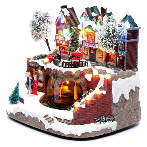 Paisaje navideño con tren en movimiento, iluminación y música 25x25x20 cm 2