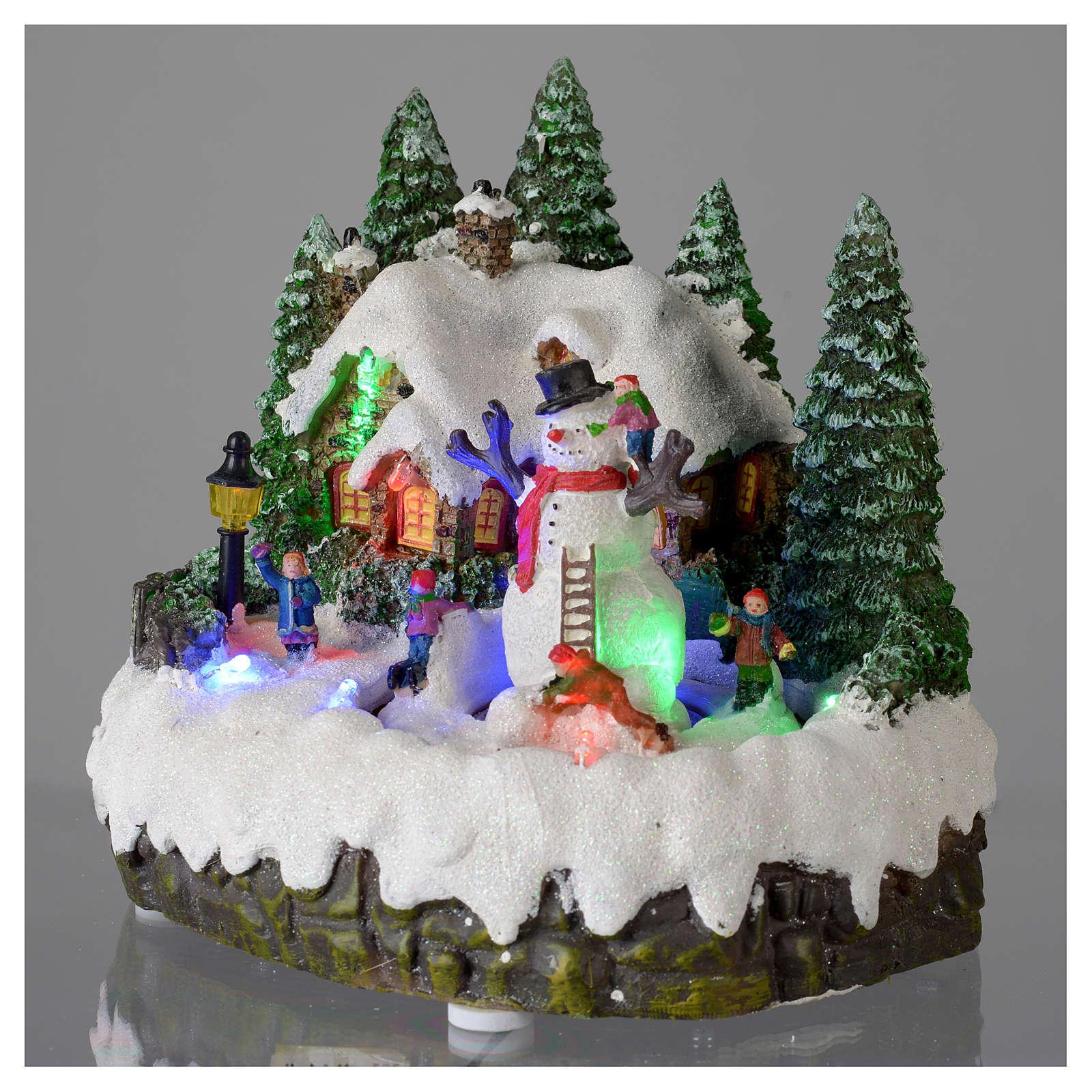 Villaggio di Natale illuminato pupazzo di neve movimento 20x20x15 cm 3