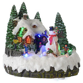 Villaggio di Natale illuminato pupazzo di neve movimento 20x20x15 cm s1
