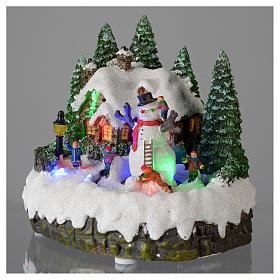 Villaggio di Natale illuminato pupazzo di neve movimento 20x20x15 cm s3