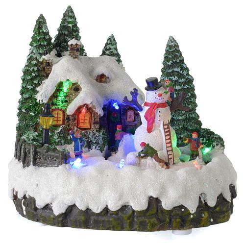 Villaggio di Natale illuminato pupazzo di neve movimento 20x20x15 cm 1
