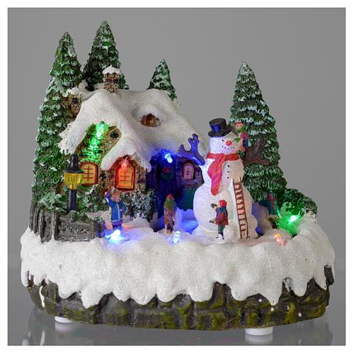 Villaggio di Natale illuminato pupazzo di neve movimento 20x20x15 cm 2