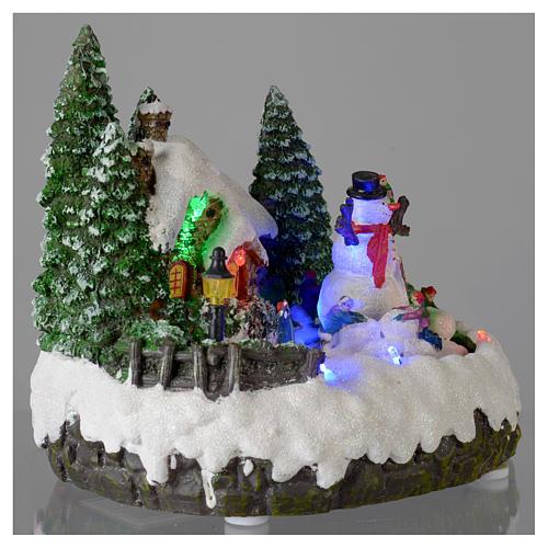 Villaggio di Natale illuminato pupazzo di neve movimento 20x20x15 cm 4