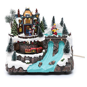 Musical christmas village with moving train and ice skating 25x25x15 cm s1