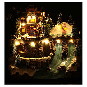 Musical christmas village with moving train and ice skating 25x25x15 cm s5