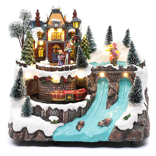 Musical christmas village with moving train and ice skating 25x25x15 cm 2
