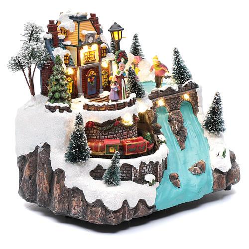 Musical christmas village with moving train and ice skating 25x25x15 cm 4