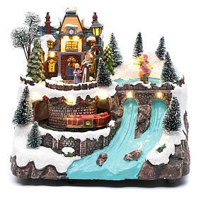 Villaggio natalizio musicale treno movimento e pattinaggio 25x25x15 cm s2
