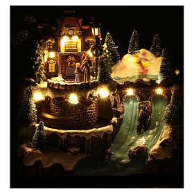 Villaggio natalizio musicale treno movimento e pattinaggio 25x25x15 cm s5