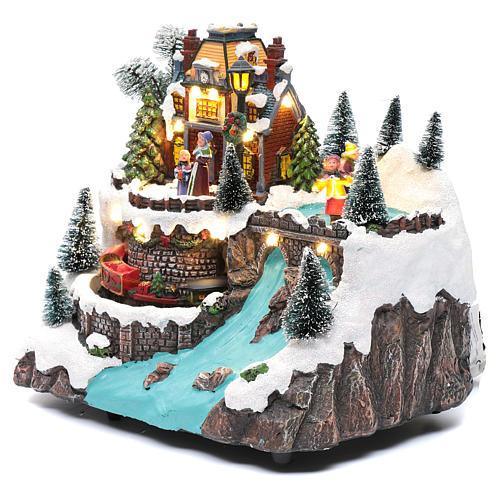 Villaggio natalizio musicale treno movimento e pattinaggio 25x25x15 cm 3