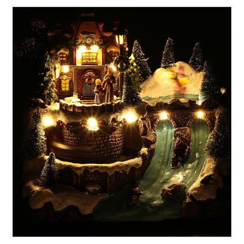 Villaggio natalizio musicale treno movimento e pattinaggio 25x25x15 cm 5