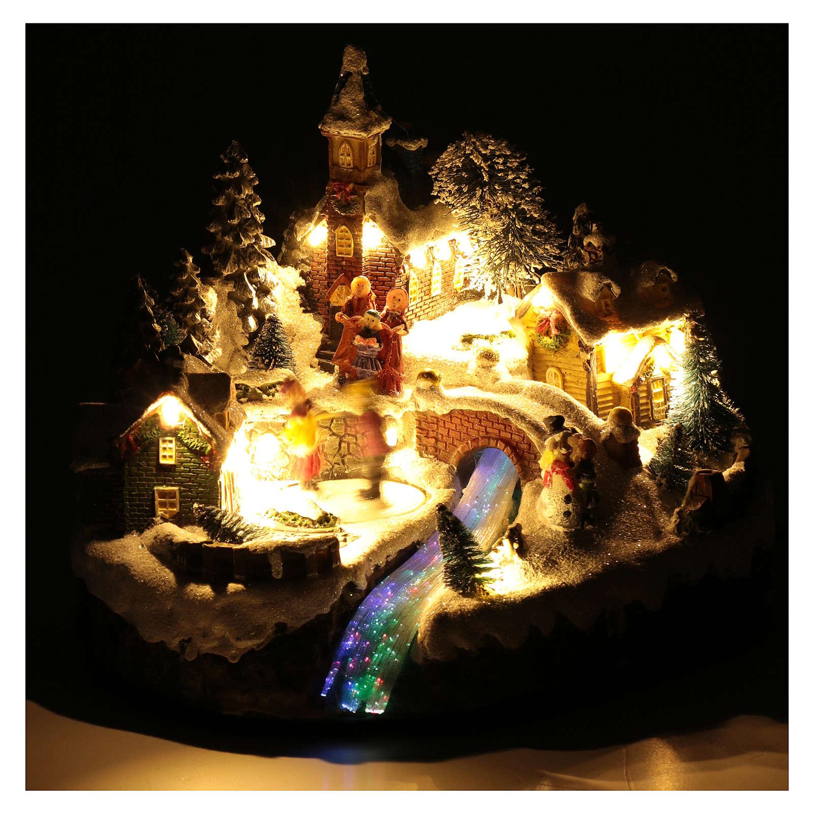 Paisaje navideño animado con patinadores y arroyo 20x25x20 cm 3