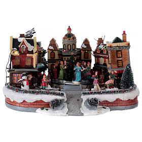 Scène de Noël avec piste de danse en mouvement 25x40x40 cm s1