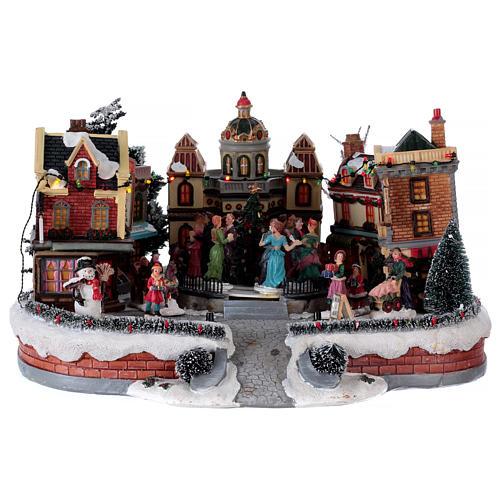 Scène de Noël avec piste de danse en mouvement 25x40x40 cm 1