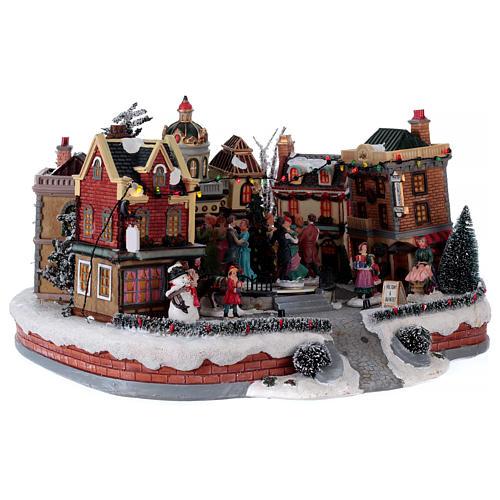 Scène de Noël avec piste de danse en mouvement 25x40x40 cm 4