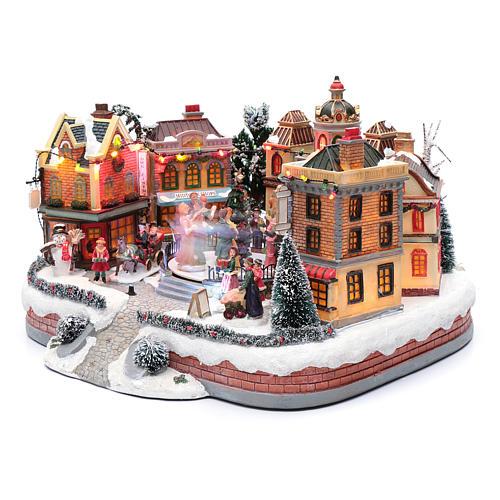 Scena di Natale con pista da ballo in movimento 25x40x40 cm 2