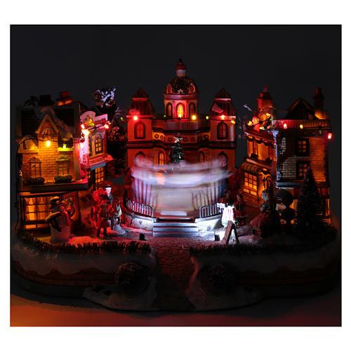 Scena di Natale con pista da ballo in movimento 25x40x40 cm 4
