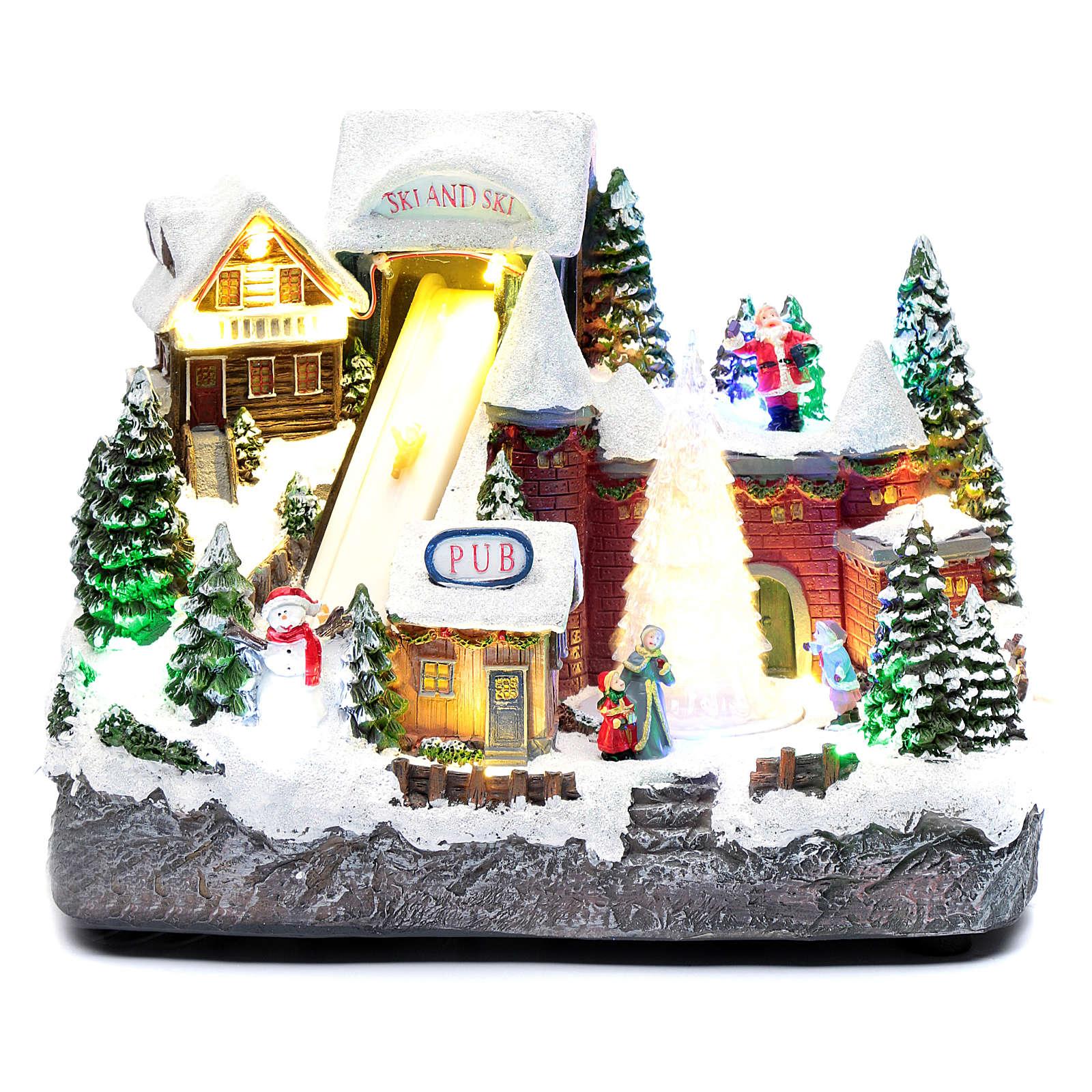 Pista da sci natalizia con albero in movimento 25x30x15 cm 3