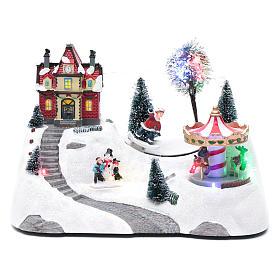 Escena navideña musical con carrusel y patinador en movimiento 20x30x15 cm s1