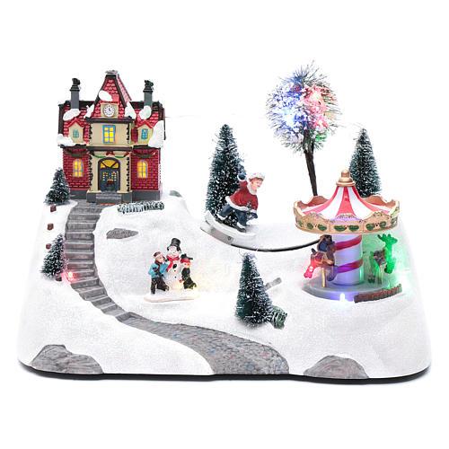 Escena navideña musical con carrusel y patinador en movimiento 20x30x15 cm 1