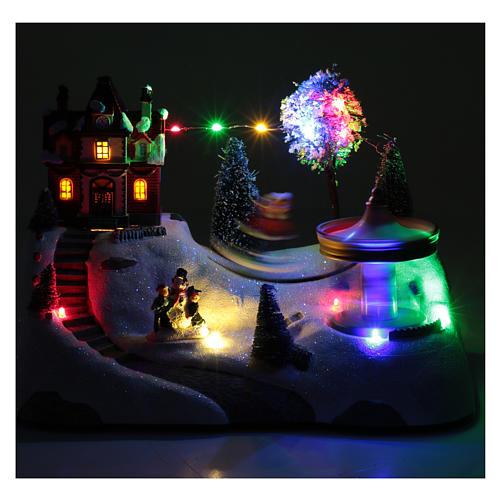Escena navideña musical con carrusel y patinador en movimiento 20x30x15 cm 4