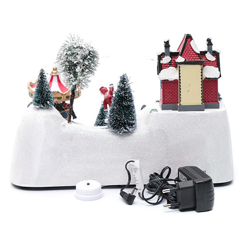 Escena navideña musical con carrusel y patinador en movimiento 20x30x15 cm 5