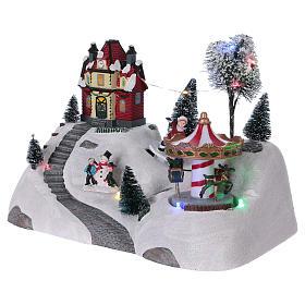 Scena natalizia musicale con giostra 20x30x15 cm s3
