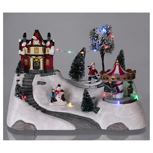 Scena natalizia musicale con giostra 20x30x15 cm 2
