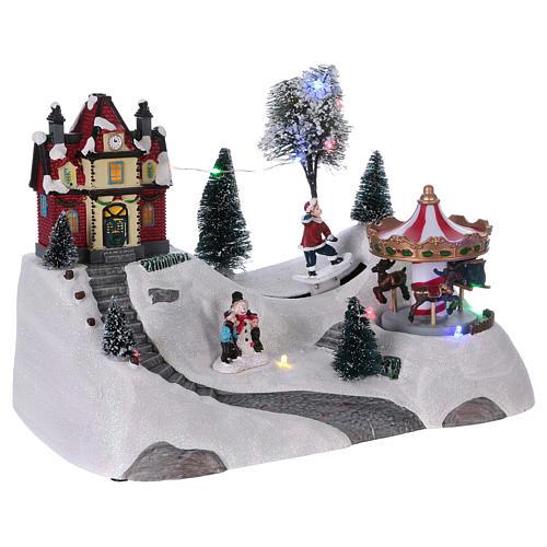 Scena natalizia musicale con giostra 20x30x15 cm 4